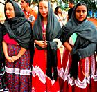 Oaxaca young women dressed with traditional clothing participates in a religious celebration in the Templo de Santo Domingo, in Oaxaca, Mexico