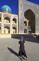 Uzbekistan; Bukhara; Mir-i-Arab Madrasa, islamic school, western tourist,.