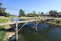 Bamboo bridge across Mae Nam Pai river, Pai, Thailand.