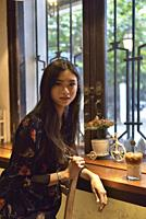 young girl at Hero Coffee cafe, Kepodang Street, Old Town of Semarang, Java island, Indonesia, Southeast Asia.