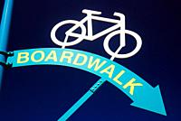 A sign points to the bike path on the boardwalk.