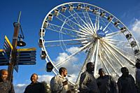 Dancing group in front of Ferris wheel, the Waterfront, Cape Town, South Africa, Africa.