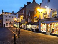 Christmas lights and the Oldest Chemist Shop in England in the Marketn Place at Knaresborough North Yorkshire England.