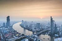 Thailand, Bangkok, Riverside Area, high angle city skyline by Chao Phraya River, dusk.