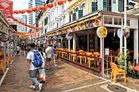 Singapore, Singapore - October 18, 2018: Tourists walking in Haji Lane near the Arab area in Kampong Glam.