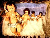 Baby Jesus (Niño Jesus) sculptures are displayed in a basket during Christmas eve in Mexico City