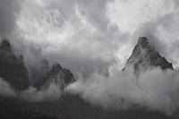 A passing rain storm brings clouds and fog to Zion Canyon at Zion National Park, Utah.