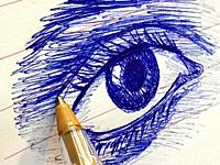 Pen drawing an eye. Close view.