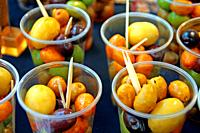 Appetizer of assorted olives in plastic cups