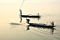 Guwahati, Assam, India. January 30, 2019. Fishermen lays their fishing net at the Brahmaputra River during sunset.