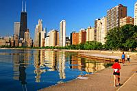 Walkers and runners traverse a trail along Chicagoâ. . s Lakefront.