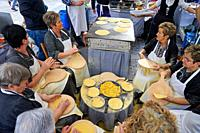 Elaboration of Talos (Cakes with corn flour), People dressed in typical baserritarra clothes, Fair of Santo Tomas, Donostia, San Sebastian, Gipuzkoa, ...