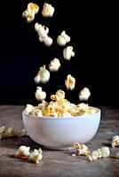 Homemade Popcorn on wooden table.