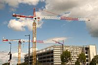 Construction cranes at Strasbourg, Alsace, France.