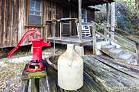 Eater pump and jug outside the Pioneer cabin at the Crowley Museum & Nature Center in Sarasota Florida.