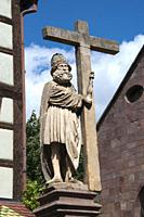 Statue of a saint holding the Cross, in Kaysersberg, Alsace, France.