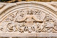 Marble reliefs in Ephesus historical ancient city, in Selcuk,Izmir,Turkey. Figure of Medusa with ornaments of Acanthus leaves,Detail of the Temple of ...