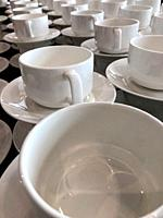 White empty ceramic cups at a buffet.