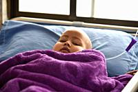 World Cancer Day. Guwahati, Assam, India. 4 February 2019. A Child Cancer patient on a bed at Dr. Bhubaneswar Borooah Cancer Institute and research ce...