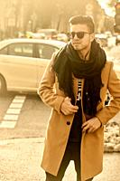 young fashionable man on street in city, male blogger with style, in Munich, Germany.