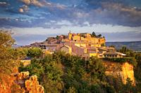 Sunrise over hilltop village of Roussillon in the Luberon, Provence France.