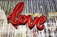 Helium Love Sign in Shop Window.