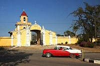 Old american car used as taxi in front of the cemetery in the town, Trinidad, Sancti Spiritus Province, Cuba, West Indies, Central America