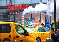 New York. Subway station for the 1, 2 and 3 lines. Midtown at 34th street and 7th Avenue on a cloudy, cold, rainy day.