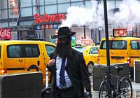New York. Subway station for the 1, 2 and 3 lines. Midtown at 34th street and 7th Avenue on a cloudy, cold, rainy day. Unknown person crossing in fron...