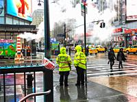 New York. Seventh Avenue at 34th street on a working day in a winter rainy time.