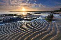 Sunrise captured from the western side of Harlyn Bay Beach, , near Padstow on the North coast of Cornwall.