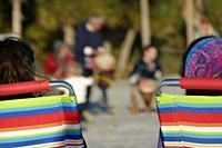 SARASOTA, FLORIDA People sitting on beach chairs at Siesta Key Beach.
