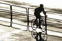Stockholm, Sweden Silhouette of bicyclist on Liljeholmsbron.