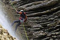 Climber descending a ravine, Broto, Pyrenees, Spain.