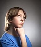 Portrait of a Boy in Blue Top Thinking.
