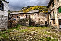 Old houses in Broto on an autumn cloudy day. Huesca. Aragon. Spain. Europe.