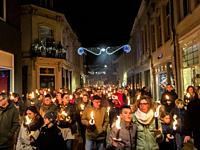 Tilburg, Netherlands. Annual, 2018 Christmas Eve torch procession for Peace roaming down town with light. The procession is a new alternative for goin...