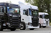 Seinäjoki, Finland - August 11, 2018. Three Next Generation Scania heavy trucks lined up on a yard, detail.