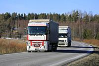 Salo, Finland - March 1, 2019: Two white semi trucks, Renault Magnum C. M. Mathieu in the front, transport goods on Finnish highway in early spring.
