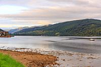 Loch Fyne lies still on a summer day in the highlands of Scotland, UK.