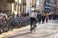 Deliveroo rider in Cambridge, UK.