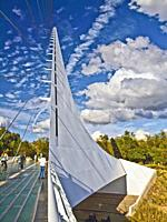 Sundial Bridge in Redding, California. This 710 foot span crosses the Sacramento River, and forms a working sundial. The glass decked bridge is used o...