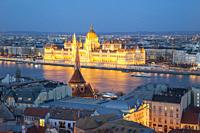 Night falls at the Hungarian Parliament in Budapest, Hungary.