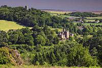 Dunster Castle in the Exmoor National Park, captured from Bat's Castle using a telephoto lens on a morning in late June.