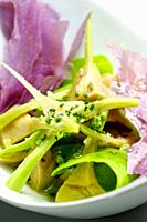 Artichoke salad and blue potato with vegetables.