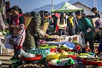 Vegetables, Friday market in Shaxi, a historic market town, Yunnan, China.
