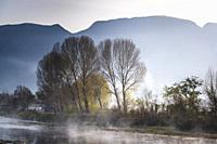 Atmospheric Landscape with river and trees near Shaxi historic market town, Yunnan, China.