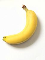 Close up of banana on white plate.