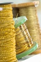 Gold and silver thread spools for cofrade crafts, Holy Week, Andalusia, Spain.
