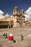View to the La Compania De Jesus Church-Iglesia De La Compania De Jesus in Plaza de Armas Square with a local woman in the foreground, Cusco, Peru, So...